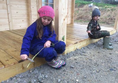 Children learning to whittle at the Wild Warriors forest school in Cornwall