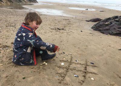 Playing at Polzeath beach