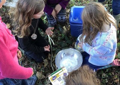 Children having a cookery lesson outdoors with Wild Warriors Forest School